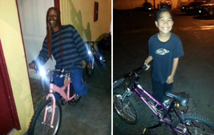 Two kids receive bikes from Motel Church volunteers on Christmas Eve
