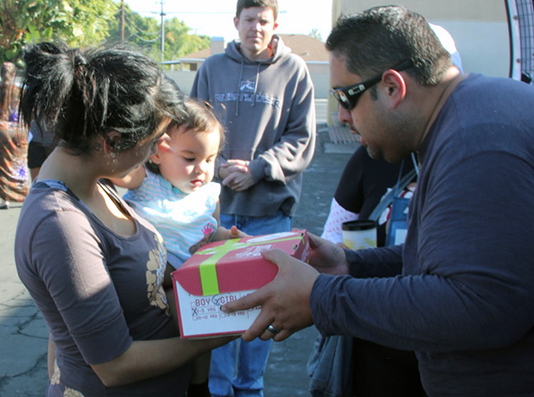 Volunteers giving away Christmas Boxes at Motel Church