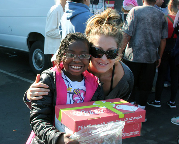 The sweetest smile from a girl getting a Christmas Box at Motel Church